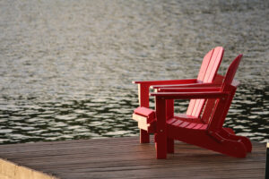Chairs by lake